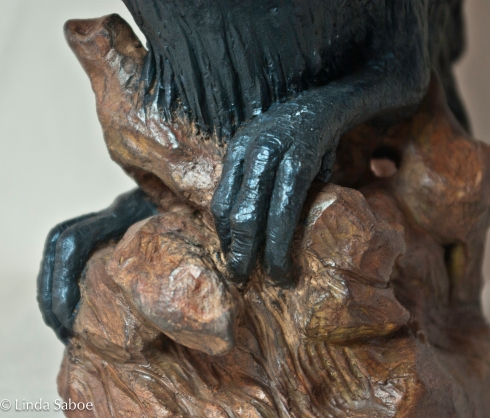 Ceramic clay, black iron oxide wash finished with pigmented wax patina.